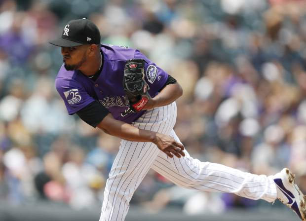 Colorado Rockies starting pitcher German Marquez works against the Oakland Athletics in the first inning of a baseball game Sunday, July 29, 2018, in Denver. (AP Photo/David Zalubowski)