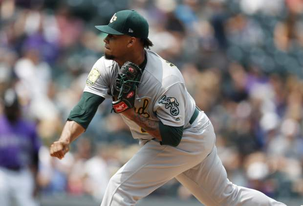 Oakland Athletics starting pitcher Frankie Montas works against the Colorado Rockies in the first inning of a baseball game Sunday, July 29, 2018, in Denver. (AP Photo/David Zalubowski)