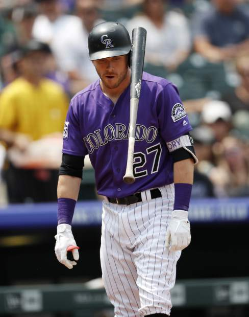 Colorado Rockies' Trevor Story reacts after striking out against Oakland Athletics starting pitcher Frankie Montas in the first inning of a baseball game Sunday, July 29, 2018, in Denver. (AP Photo/David Zalubowski)