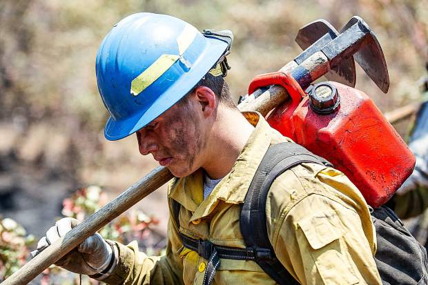 Oregon firefighter Martin Sierra walking back from the line on the Lake Christine Fire on Sunday afternoon.