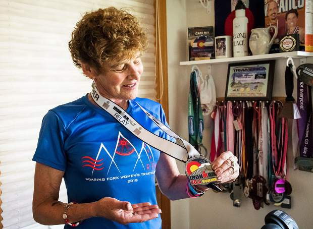 Nancy Reinisch holds the Ironman Half Marathon medal she received after finishing the race. This has been her proudest achievement due to the level of intense training that was involved and the difficulty of the race.