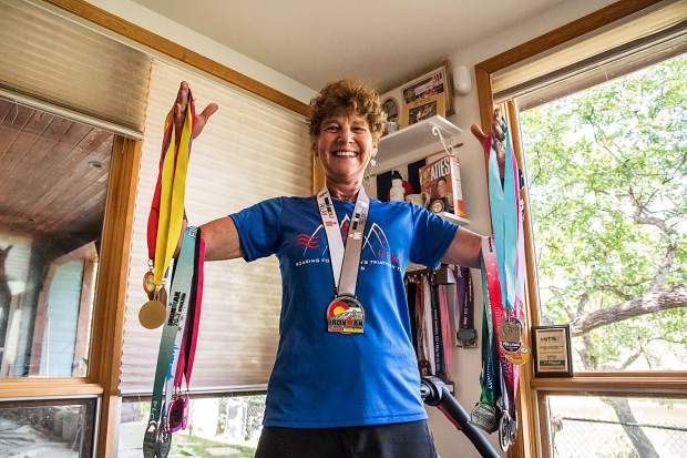 Nancy Reinisch holds only a fraction of the medals she has collected over the years of racing and competing in triathlons and other races.