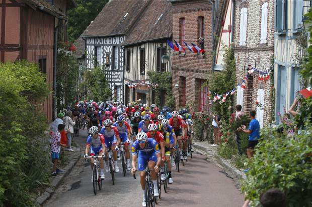In this Saturday, July 14, 2018, image, Belgium's Tim Declercq, leading the pack in blue front right, is what cycling refers to as a