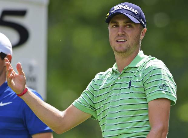 Justin Thomas reacts to his tee shot on the fifth hole during the final round of the Bridgestone Invitational golf tournament at Firestone Country Club, Sunday, Aug. 5, 2018, in Akron, Ohio. (AP Photo/David Dermer)