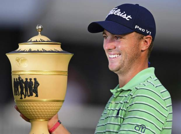 Justin Thomas holds the Gary Player Cup trophy after winning the final round of the Bridgestone Invitational golf tournament at Firestone Country Club, Sunday, Aug. 5, 2018, in Akron, Ohio. (AP Photo/David Dermer)