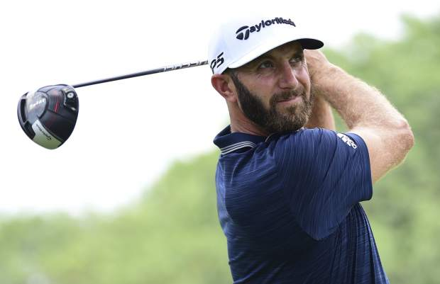 Dustin Johnson watches his tee shot on the 10th hole during the final round of the Bridgestone Invitational golf tournament at Firestone Country Club, Sunday, Aug. 5, 2018, in Akron, Ohio. (AP Photo/David Dermer)