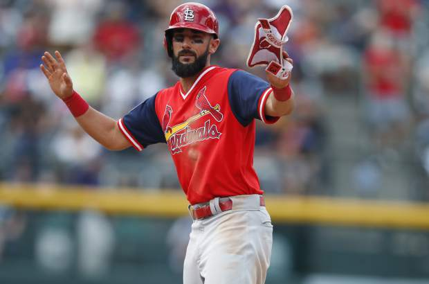 St. Louis Cardinals' Matt Carpenter gestures after hitting a double off Colorado Rockies relief pitcher Bryan Shaw in the seventh inning of a baseball game Sunday, Aug. 26, 2018, in Denver. (AP Photo/David Zalubowski)