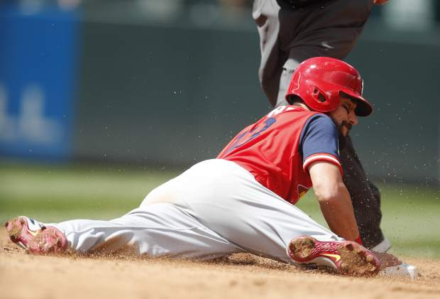 St. Louis Cardinals' Matt Carpenter slides safely into second base with a double off Colorado Rockies relief pitcher Chad Bettis in the third inning of a baseball game Sunday, Aug. 26, 2018, in Denver. (AP Photo/David Zalubowski)