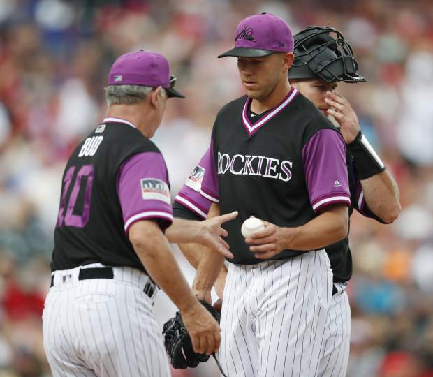 Colorado Rockies manager Bud Black, left, takes the ball from starting pitcher Tyler Anderson as he is pulled from the mound against the St. Louis Cardinals in the first inning of a baseball game Sunday, Aug. 26, 2018, in Denver. (AP Photo/David Zalubowski)