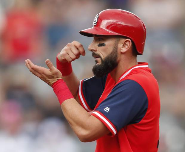 St. Louis Cardinals' Matt Carpenter gestures to the dugout after his RBI-double off Colorado Rockies starting pitcher Tyler Anderson in the first inning of a baseball game Sunday, Aug. 26, 2018, in Denver. (AP Photo/David Zalubowski)