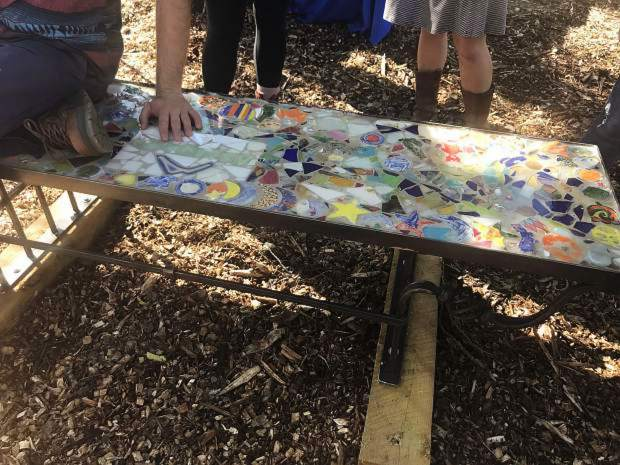 A mosaic bench is one of the many artistic features situated along the Rio Grande Artway in Carbondale, one of the many projects that have helped define Carbondale's Creative District.