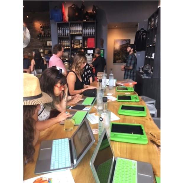 Participants take the Carbondale Affordable Creative Space survey on iPads during a