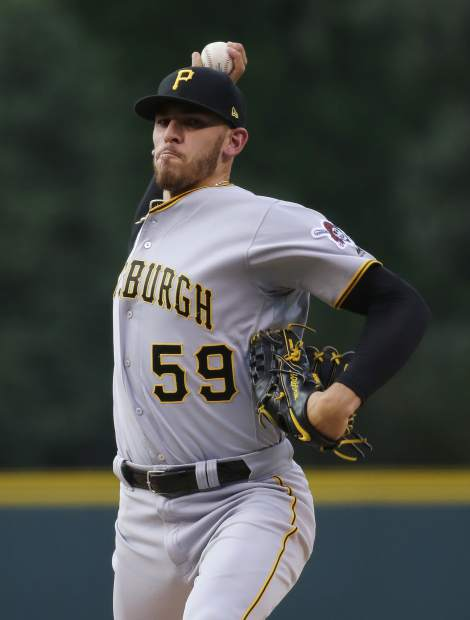 Pittsburgh Pirates starting pitcher Joe Musgrove throws against the Colorado Rockies during the first inning of a baseball game, Monday, Aug. 6, 2018, in Denver. (AP Photo/Jack Dempsey)