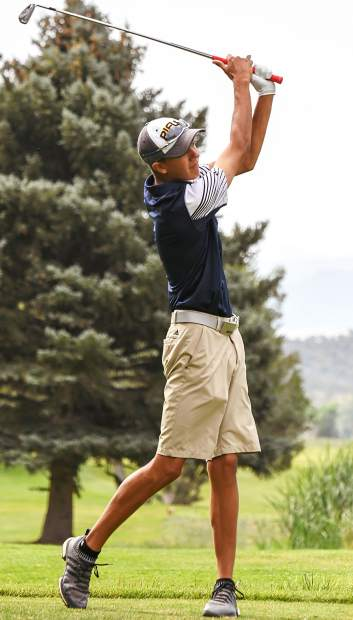 Rifle High School junior Wolfgang Smith tees off during Tuesday's tournament at Rifle Creek.