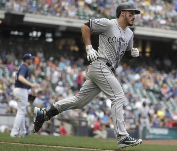 Colorado Rockies' Nolan Arenado hits a home run during the 11th inning of a baseball game against the Milwaukee Brewers Sunday, Aug. 5, 2018, in Milwaukee. (AP Photo/Morry Gash)