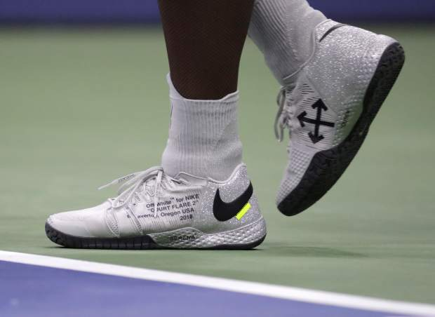 Serena Williams walks behind the baseline during a first-round match against Magda Linette, of Poland, at the U.S. Open tennis tournament, Monday, Aug. 27, 2018, in New York. (AP Photo/Julio Cortez)