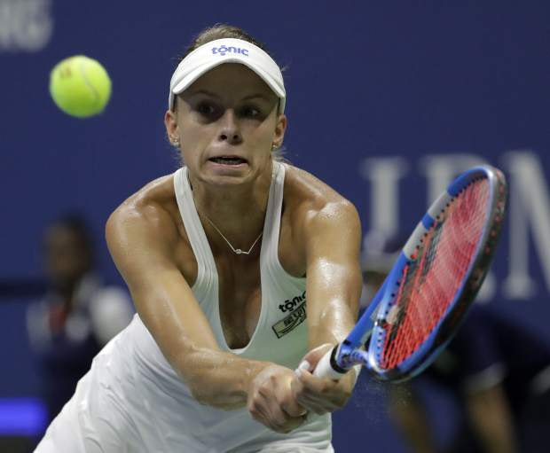 Magda Linette, of Poland, returns a shot to Serena Williams during the first round of the U.S. Open tennis tournament, Monday, Aug. 27, 2018, in New York. (AP Photo/Julio Cortez)