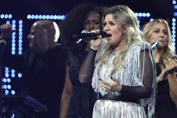 Kelly Clarkson performs at the opening night ceremony of the U.S. Open tennis tournament at the USTA Billie Jean King National Tennis Center on Monday, Aug. 27, 2018, in New York. (Photo by Greg Allen/Invision/AP)