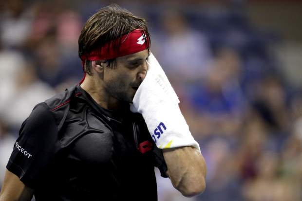 David Ferrer, of Spain, reacts after losing a point to Rafael Nadal, also of Spain, during the first round of the U.S. Open tennis tournament, Monday, Aug. 27, 2018, in New York. (AP Photo/Julio Cortez)