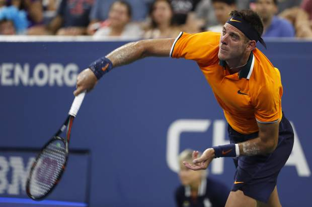 Juan Martin del Potro, of Argentina, serves to Donald Young during the first round of the U.S. Open tennis tournament, Monday, Aug. 27, 2018, in New York. (AP Photo/Adam Hunger)