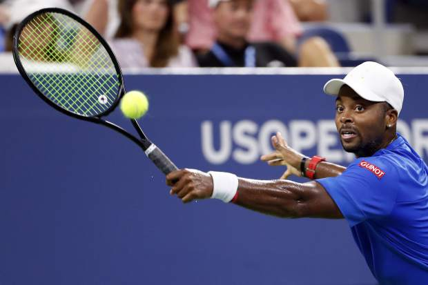 Donald Young returns a shot to Juan Martin del Potro, of Argentina, during the first round of the U.S. Open tennis tournament, Monday, Aug. 27, 2018, in New York. (AP Photo/Adam Hunger)