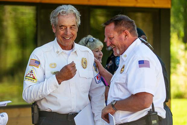 Aspen Fire Chief Rick Balentine (left) and Basalt-Snowmass Village Fire Chief Scott Thompson share a laugh Thursday before a ceremony where the Roaring Fork Conservancy awarded checks to the agencies.