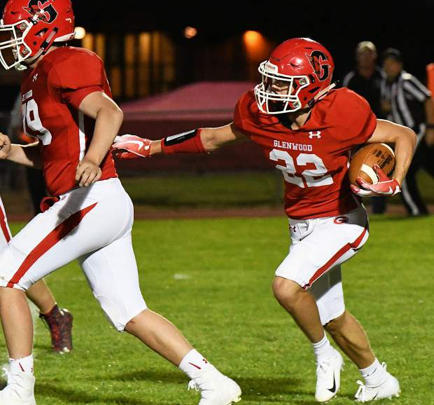 Glenwood Springs Demon Gavin Olson runs the ball down the field during Friday night's game against the Holy Family Tigers at Stubler Memorial Field.