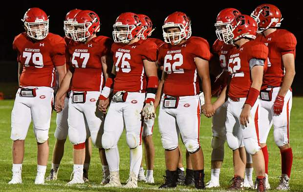 The Glenwood Springs Demon offensive line wait for the play call during Friday night's game against the Holy Family Tigers at Stubler Memorial Field.