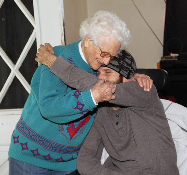 Maryhannah Throm interacting with one of her Meals on Wheels clients.