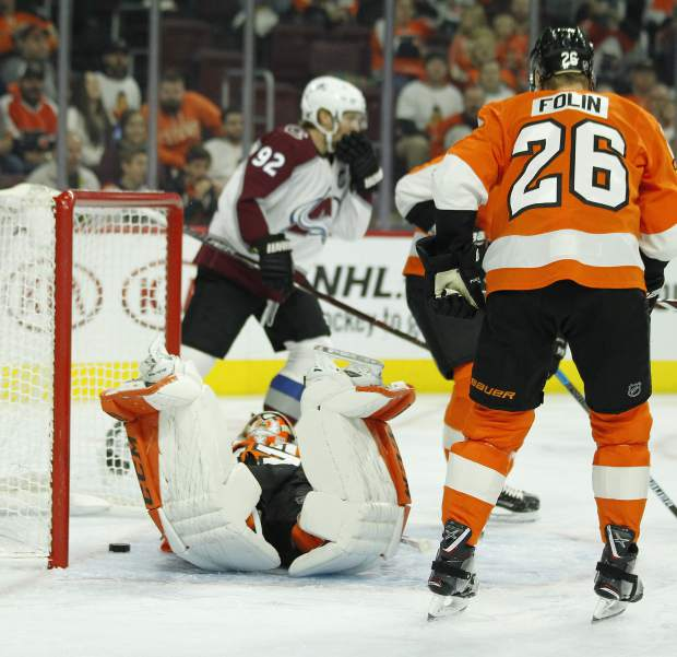 Philadelphia Flyers goalie Brian Elliott lies on his stomach after the goal by Colorado Avalanche's Mikko Rantanen during the first period of an NHL hockey game, Monday, Oct. 22, 2018, in Philadelphia. At right is Flyers' Christian Folin. (AP Photo/Tom Mihalek)