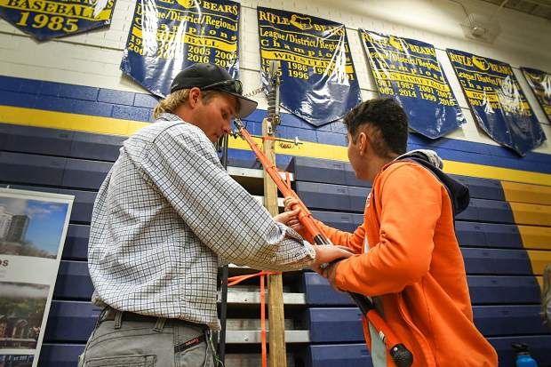 Holy Cross Energy representative Trenton Jole shows Grand Valley High School student Guyli Hernandez how to operate some equipment at the career fair at Rifle High School on Wednesday morning.