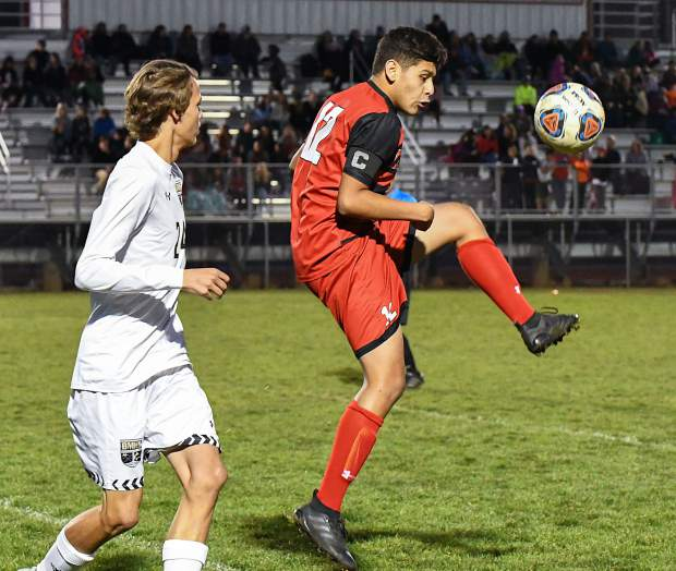 Glenwood Springs Demon Leo Mireles wins possession of the 50/50 ball during Tuesday night's game at Stubler Memorial Field.