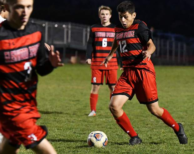 Glenwood Springs Demon Leo Mireles dribbles the ball down the field during Tuesday night's game against the Battle Mountain Huskies at Stubler Memorial Field.