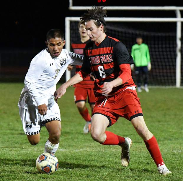 Glenwood Springs Demon Liam Mazzotta dribbles the ball down the field during Tuesday night's game against the Battle Mountain Huskies at Stubler Memorial Field.