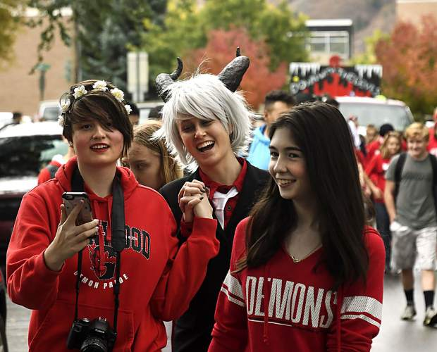 Glenwood Springs High School students make their way down Pitkin Avenue as the 2018 Homecoming parade begins Friday.