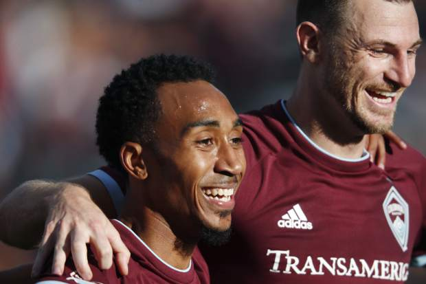 Colorado Rapids midfielder Marlon Hairston, left, congratulates defender Tommy Smith after Smith scored the go-ahead goal against FC Dallas in the second half of an MLS soccer match Sunday, Oct. 28, 2018, in Commerce City, Colo. (AP Photo/David Zalubowski)