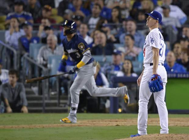 Los Angeles Dodgers starting pitcher Walker Buehler watches after Milwaukee Brewers' Orlando Arcia hits a two-run home run during the seventh inning of Game 3 of the National League Championship Series baseball game Monday, Oct. 15, 2018, in Los Angeles. (AP Photo/Mark J. Terrill)
