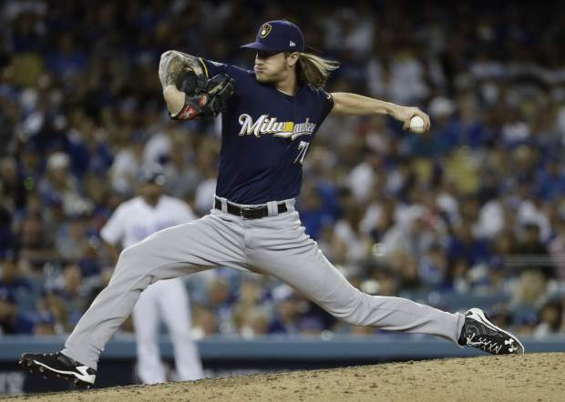 Milwaukee Brewers relief pitcher Josh Hader throws during the eighth inning of Game 3 of the National League Championship Series baseball game against the Los Angeles Dodgers Monday, Oct. 15, 2018, in Los Angeles. (AP Photo/Matt Slocum)