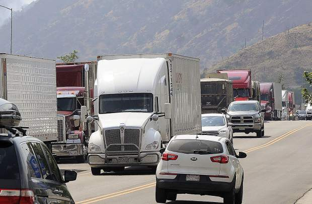 Tractor-trailers line U.S. Highway 6 in West Glenwood last summer. The city of Glenwood Springs is concerned CDOT's plan to accomodate more parking whithin the highway corridor.