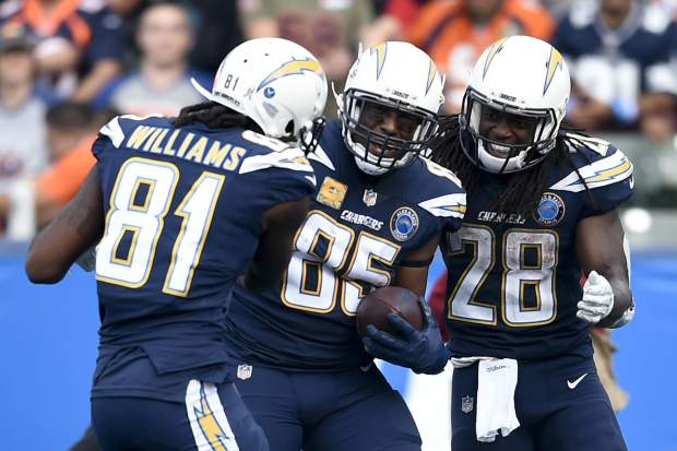 Los Angeles Chargers tight end Antonio Gates, middle, celebrates after scoring with Mike Williams and Melvin Gordon right, during the second half of an NFL football game against the Denver Broncos Sunday, Nov. 18, 2018, in Carson, Calif. (AP Photo/Kelvin Kuo)