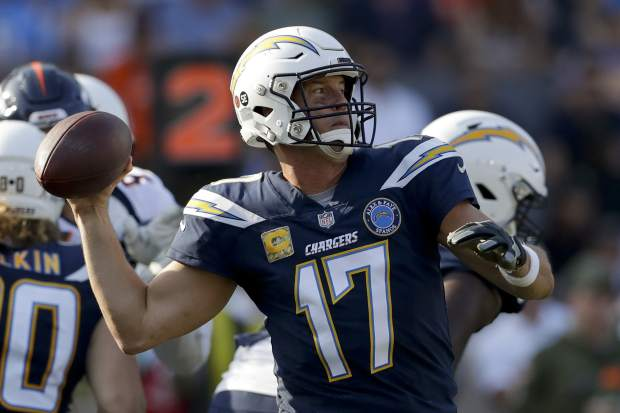 Los Angeles Chargers quarterback Philip Rivers passes against the Denver Broncos during the first half of an NFL football game Sunday, Nov. 18, 2018, in Carson, Calif. (AP Photo/Marcio Jose Sanchez)