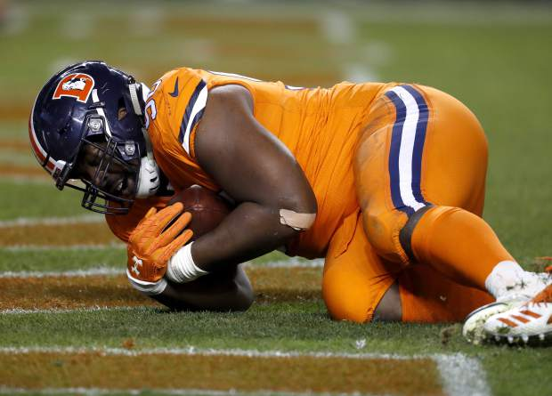 Denver Broncos defensive end Shelby Harris (96) intercepts a pass in the end zone against the Pittsburgh Steelers during the second half of an NFL football game, Sunday, Nov. 25, 2018, in Denver. (AP Photo/David Zalubowski)