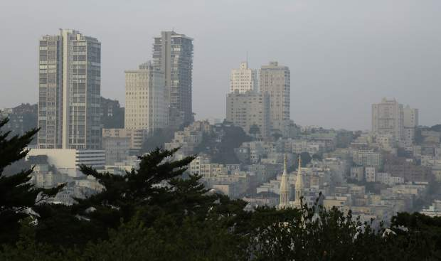 Smoke and haze from wildfires hovers over Russian Hill Monday, Nov. 19, 2018, in San Francisco. (AP Photo/Eric Risberg)