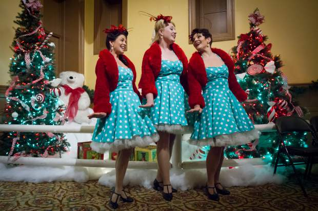 The Denver Dolls sing carols for the crowds at the 28th annual Festival of Lights at the Hotel Colorado last year.