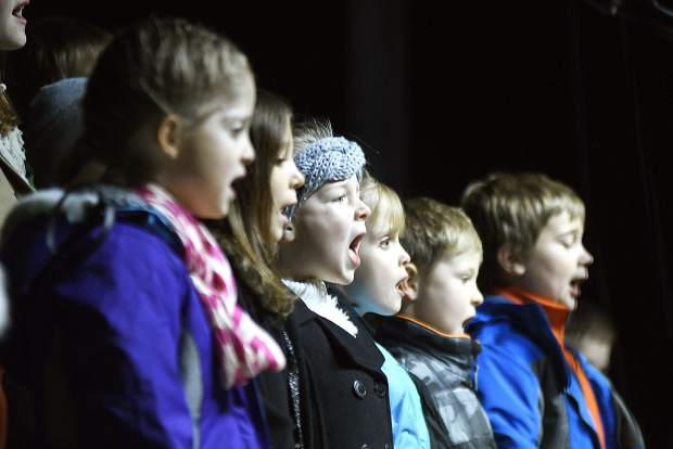 Students from Liberty Classical School entertain the crowd with Christmas carols Friday during the 29th annual Festival of Lights at the Hotel Colorado.