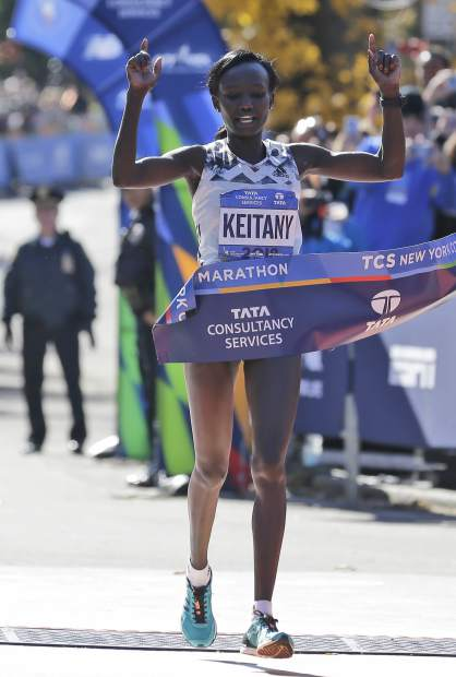 Mary Keitany of Kenya crosses the finish line first in the women's division of the New York City Marathon in New York, Sunday, Nov. 4, 2018. (AP Photo/Seth Wenig)