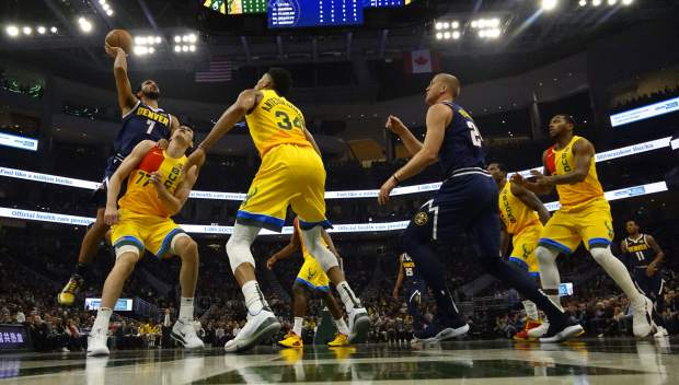 Denver Nuggets' Trey Lyles shoots over Milwaukee Bucks' Ersan Ilyasova during the first half of an NBA basketball game Monday, Nov. 19, 2018, in Milwaukee. (AP Photo/Morry Gash)