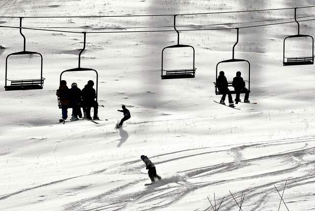 A pair of snowboarders take some turns in the fresh snow Friday as the Tercero lift takes more skiers and riders up Sunlight Mountain Resort. Sunlight celebrated its 52nd season with one of the resort's earliest openings ever.