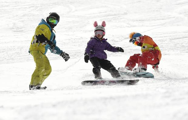 Sunlight Mountain Resort thrives with activity as a trio of riders take to the slopes Friday as the resort celebrates its 52nd season.