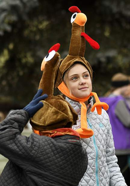 Participants in last year's Turkey Day 5K get into the holiday spirit as they wait for the start.